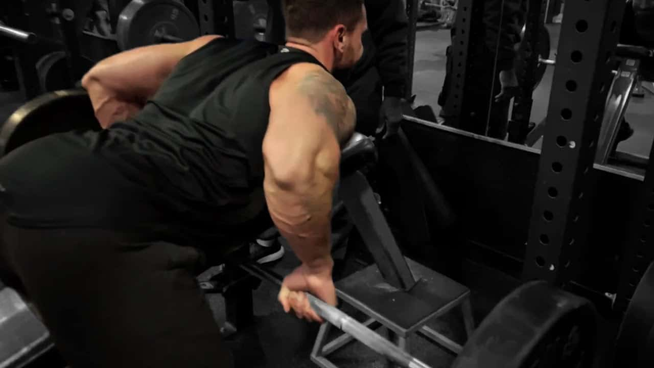Troy bent over row with vest add weight