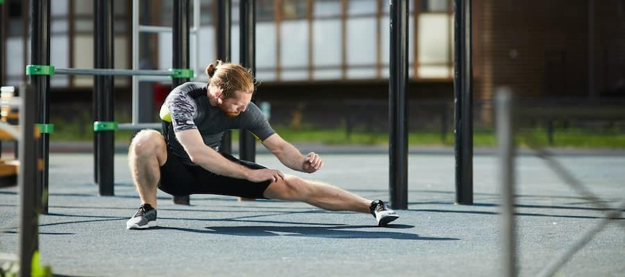 man doing side to side lunge