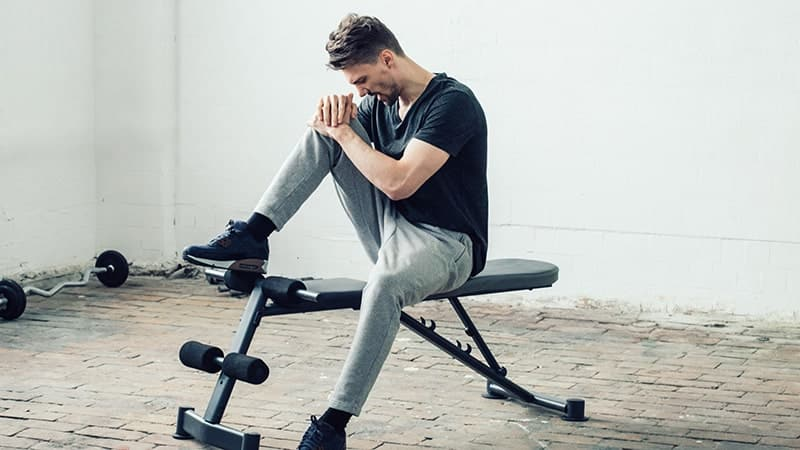 handsome guy in sport gym injury pain