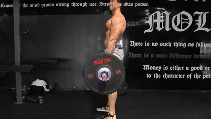 Troy doing a barbell deadlift at the gym