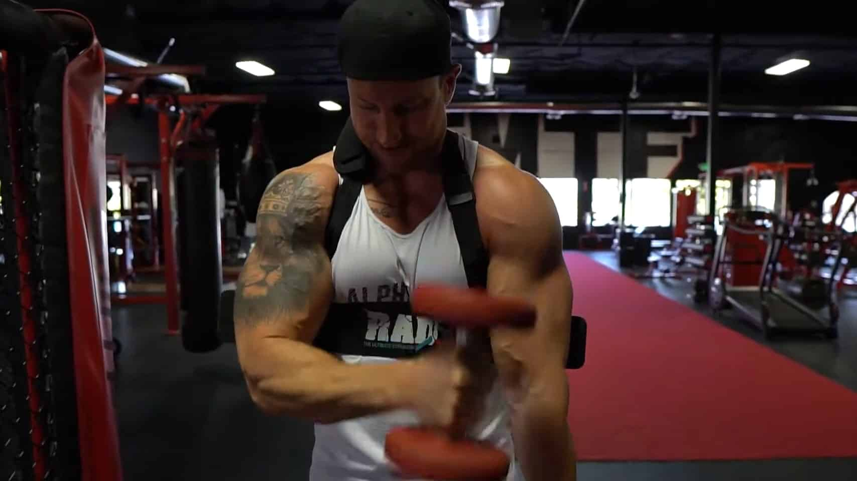 Troy doing a cross body hammer curl using a bicep blaster