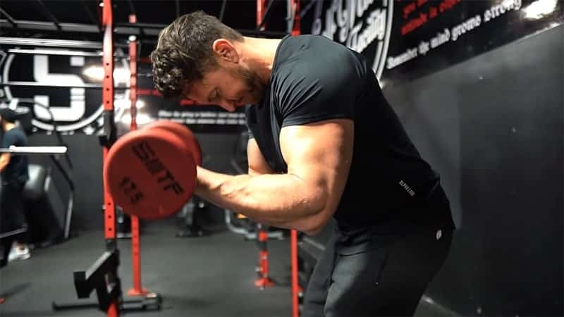 Troy doing bicep curl variations with elbows in front of the body