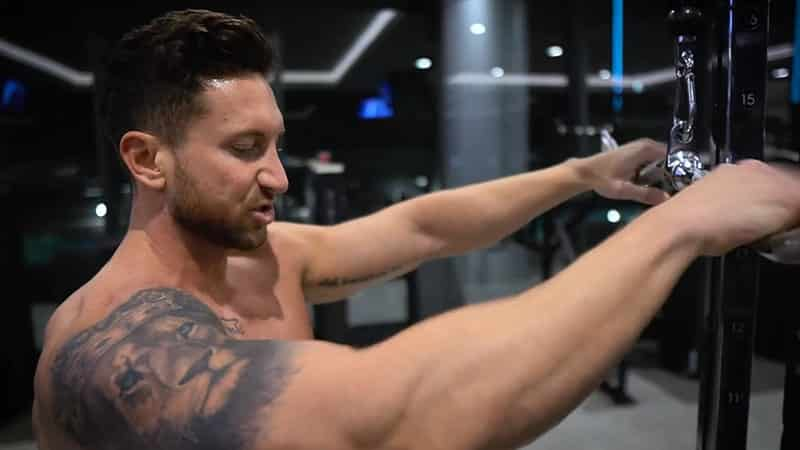 Troy performing a cable pull over with correct arm form