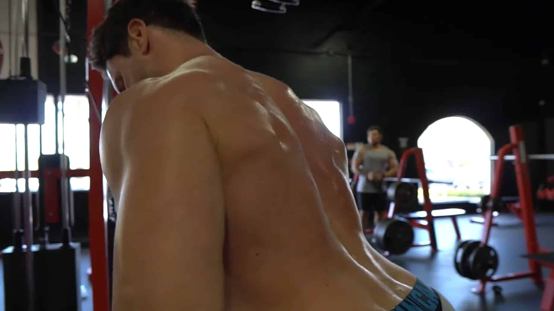 Troy performing a cable pull over with correct shoulder form