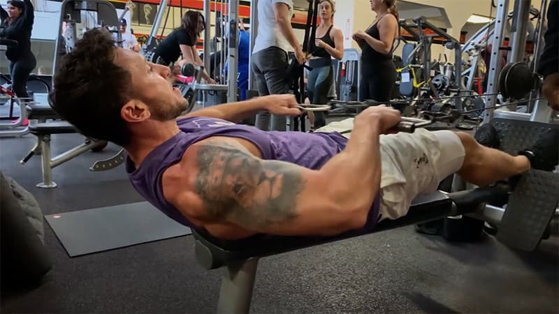 Troy performing a lying cable pull over