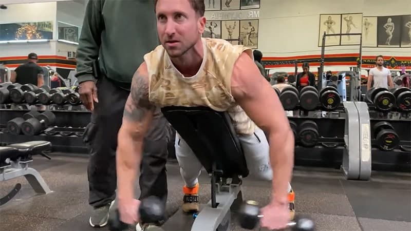 Troy performing an incline rear dumbbell raise