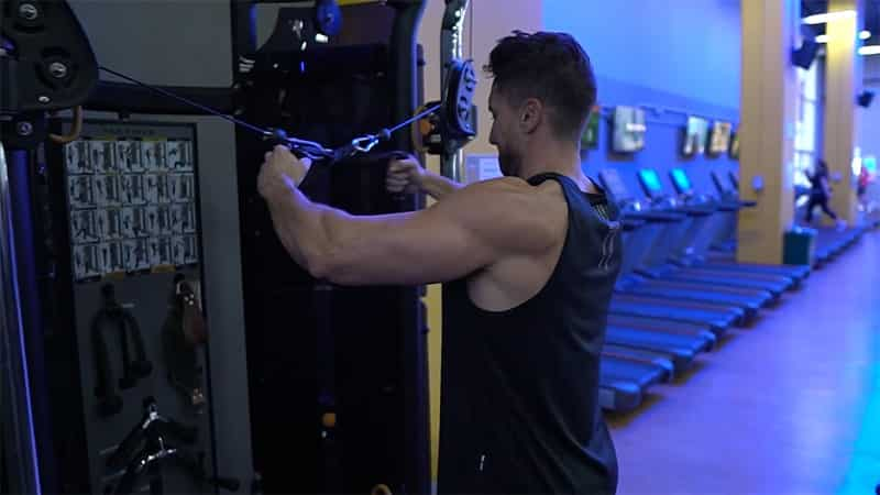 Troy preparing to do a cable rear delt fly at the gym