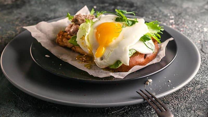 cod eggs veggies on a plate