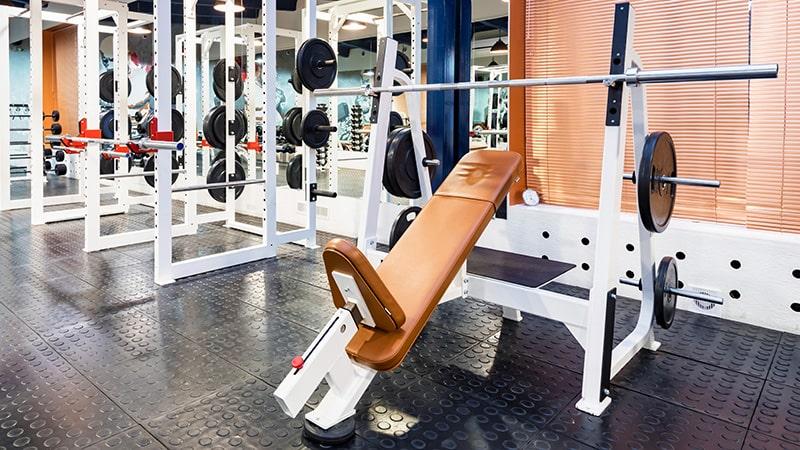 empty bench press exercise machine in modern gym