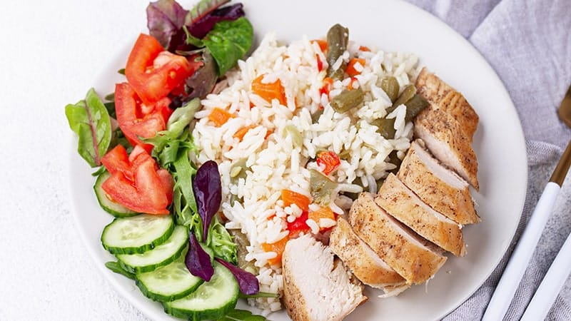 grilled chicken breast with rice and vegetables