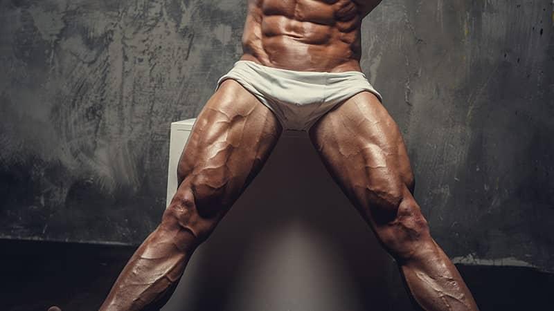 muscular man in white panties showing off his legs