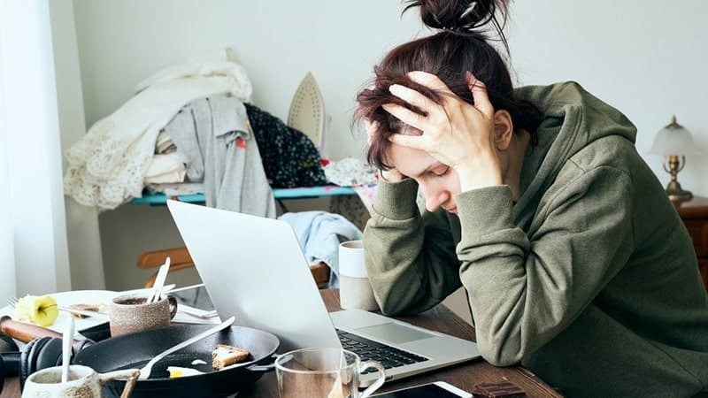woman in panic and stress chores apartment is mess and dirt