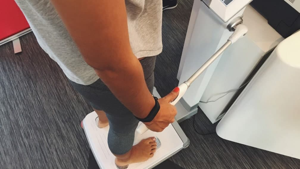 woman on scales checking her body fat