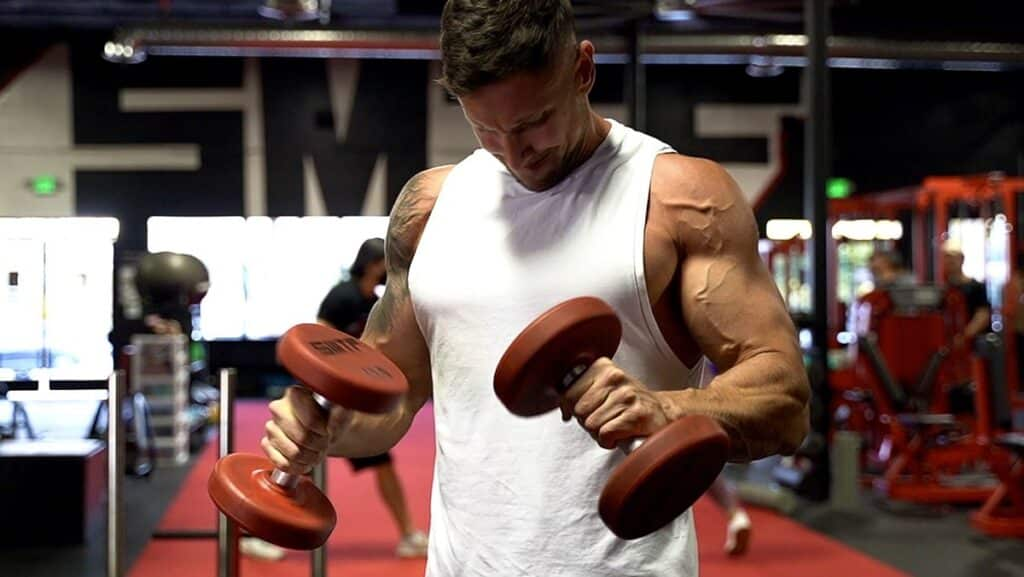 Troy doing a dumbbell shoulder workout