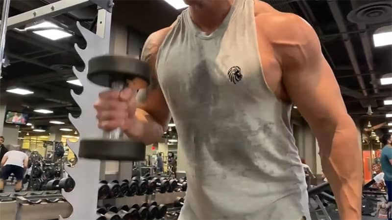 Troy doing dumbbell hammer curls at correct speed