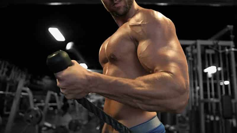 Troy doing hammer curls with rope