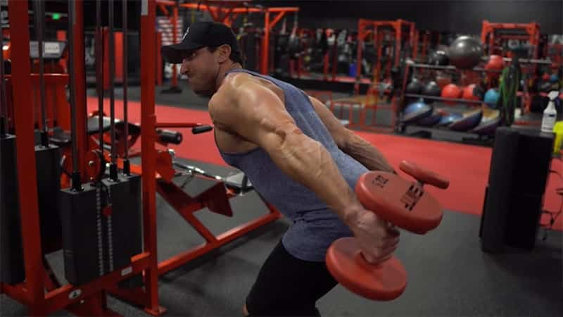 Troy doing tricep kickbacks with dumbbells