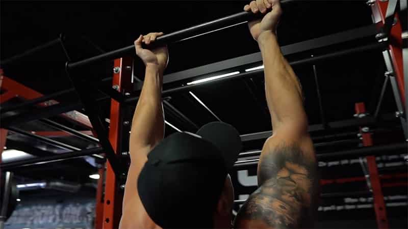 Troy gripping the bar to perform chin ups