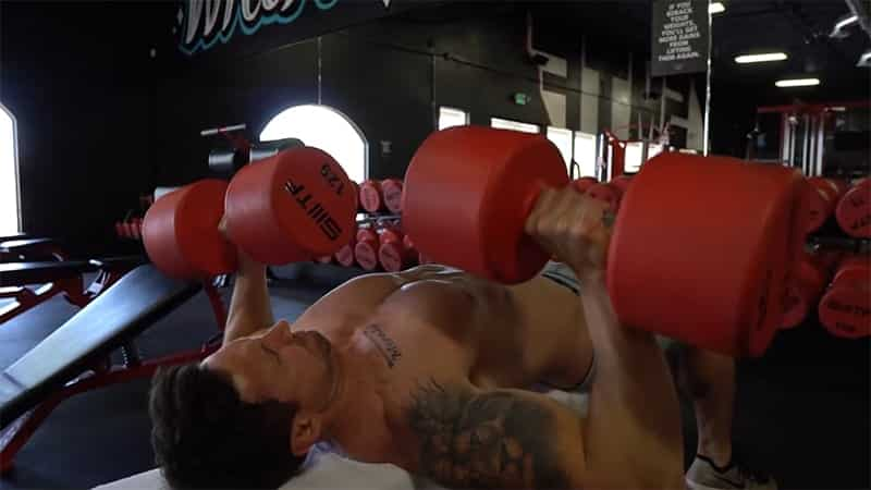 Troy lowering the weights during a dumbbell bench press