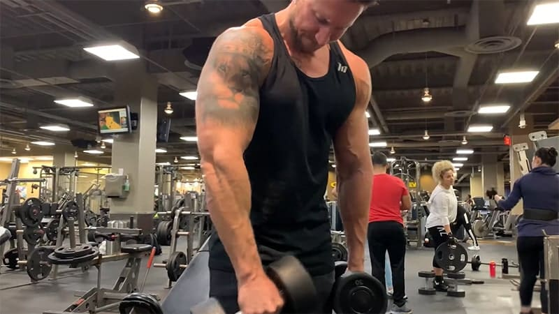 Troy performing a cross body hammer curl with correct form