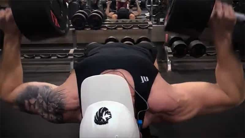 Troy performing a dumbbell bench press