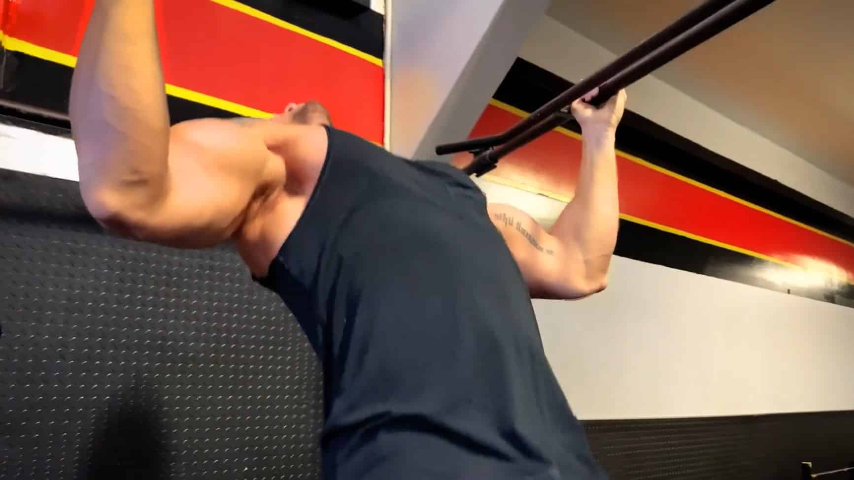 Troy performing a wide grip pull up
