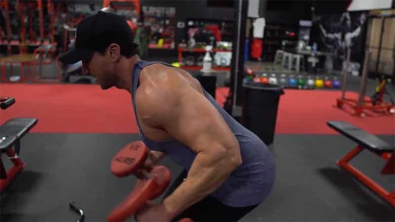 Troy performing dumbbell kickbacks with correct form