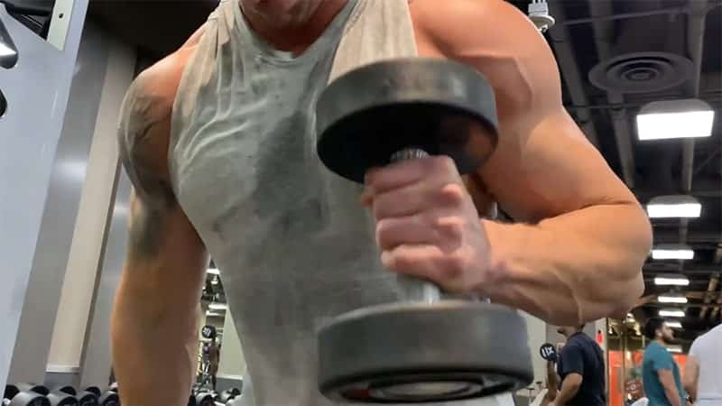Troy performing hammer concentration curls with dumbbells
