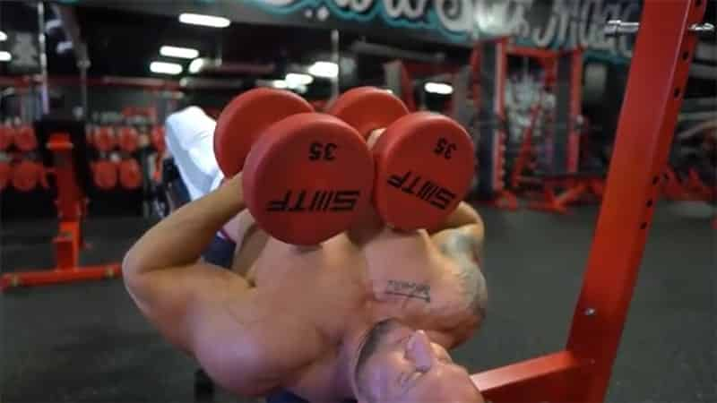Troy working out with dumbbells on a decline bench