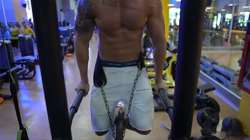 front photo of Troy doing chest dips