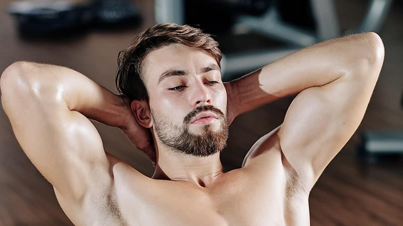 young man doing crunches with proper form