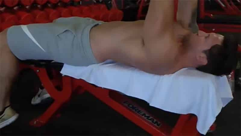 Troy doing a dumbbell pullover with correct form