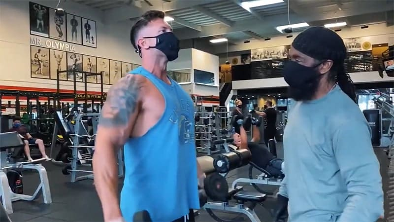 Troy doing dumbbell lateral raises with Charles Glass