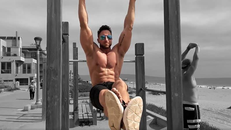 Troy doing hanging knee raises outside