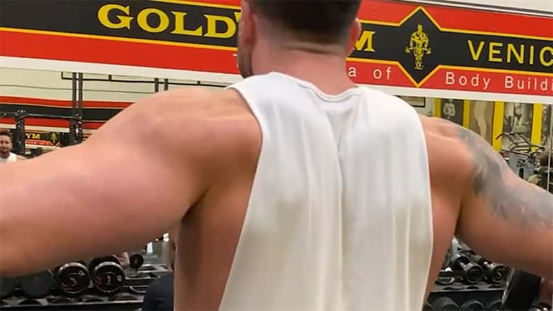 Troy working his delts with dumbbell lateral raises