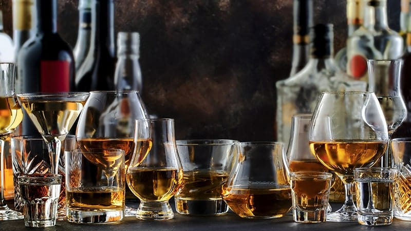 hard strong alcoholic drinks and distillates in glasses
