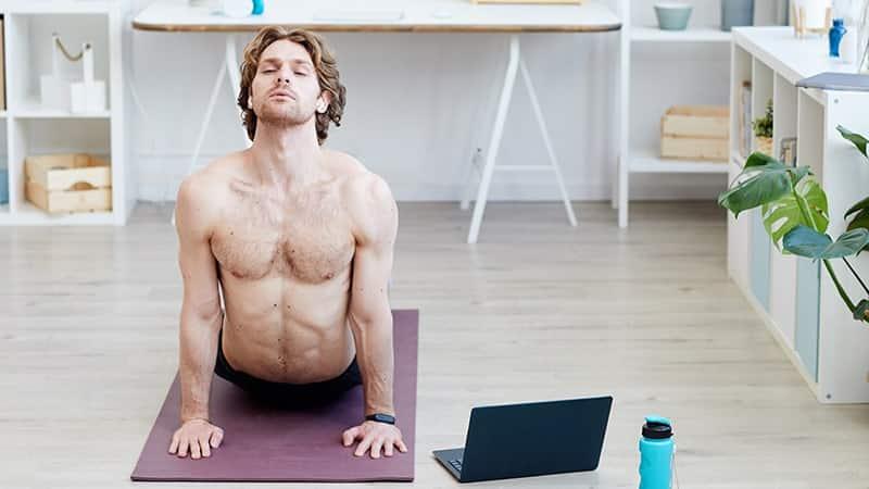 man doing yoga online
